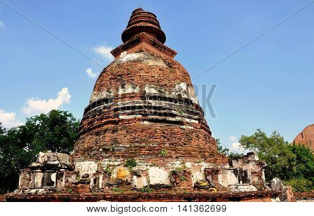 Ayutthaya Thailand - December 21 2010: Only the bell-shaped base of the great Chedi remains at 15th century Wat Maheyong