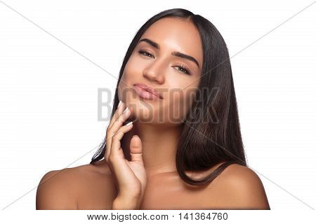Beauty Woman face Portrait Girl with Perfect Fresh Clean Skin female looking at camera smiling.Youth and Skin Care Concept.Cheerful girl is touching her cheeks pleasure.Isolated on white background