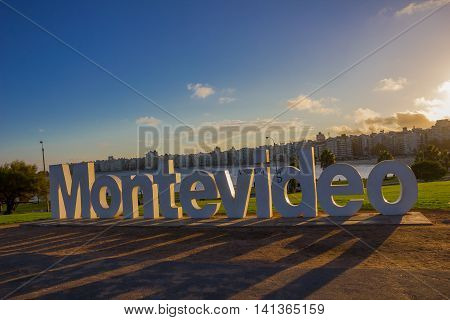 MONTEVIDEO, URUGUAY - MAY 04, 2016: montevideo's sign damaged by some graffitis with the city as background.