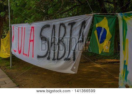PORTO ALEGRE, BRAZIL - MAY 06, 2016: political protest banner against the ex prsident of brazil, lula da silva.