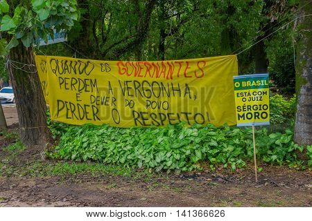 PORTO ALEGRE, BRAZIL - MAY 06, 2016: protest banner against the government of brazil, banners located in a city park.