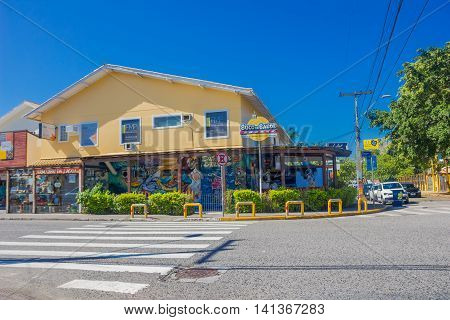 FLORIANOPOLIS, BRAZIL - MAY 08, 2016: nice view of a yellow restaurant with some grafittis at the entrance located in a corner.