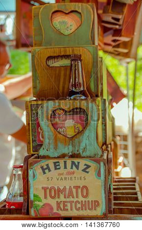 CURITIBA , BRAZIL - MAY 12, 2016: nice wood boxes painted with some publicity, heinz ketchup advertisment painted in the biggest box, cocacola glass bottle placed inside of one box.