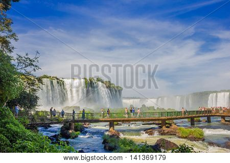 IGUAZU, BRAZIL - MAY 14, 2016: nice view from the brazilian side of a little bridge over the river located close to the bottom of the falls.
