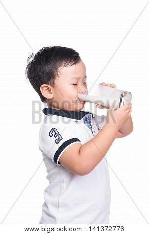 Little Boy with Glass of Milk Isolated on White Background. Adorable baby boy with dringking milk with milk mustache holding glass of milk