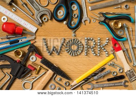 I love my job sign heart with tools on wooden background. Love work symbol heart . Happy at work. Heart composition with screws nails bolts dowels and tools on wooden background