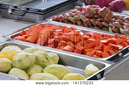 The variety of tropical fruit in the metal tray for sell in the market.