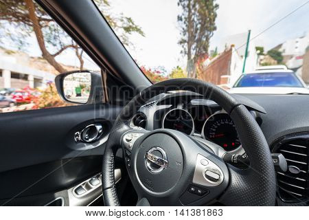 SPAIN - APRIL 21, 2016: Interior of new Nissan Juke, city cross over vehicle. The Nissan Juke is a mini sport utility vehicle (SUV) produced by the Japanese manufacturer Nissan sience 2010.