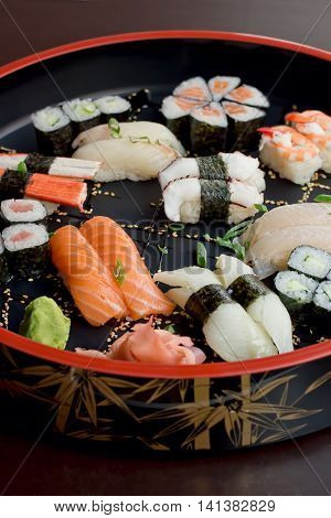 variety of sushi on a bamboo tray, side shot, vibrant