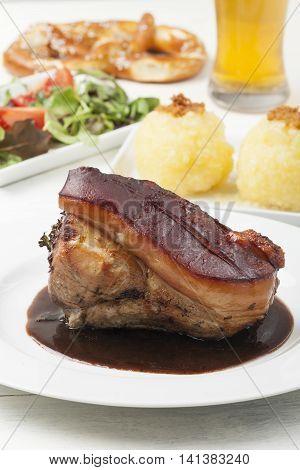 frankonian schaeufele roasted pork portion with beer