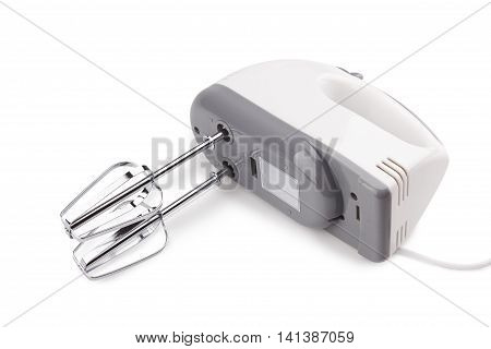 Electrical hand mixer and dishware isolated on a white