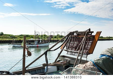 Dredge  snow blower for fishing bivalve shellfish mounted on a fishing boat