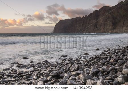 Cliffs of Los Gigantes at sunset Los Gigantes is a resort town on Tenerife Canary Islands Spain