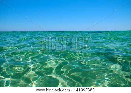 Crystal emerald sea water sparkling in the sun.