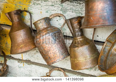 Large old antique copper cans hanging on the wall
