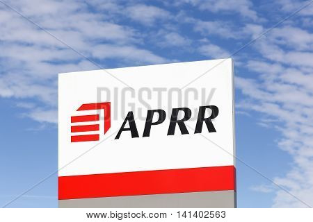 Auxerre, France - June 28, 2016: APRR sign on a panel. APRR motorway network is located in the heart of Western Europe. APRR is the fourth largest tolled motorway group in Europe