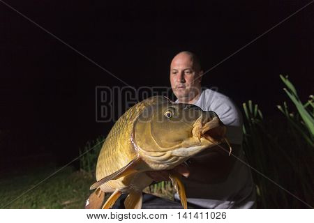 Angler with carp fishing trophy Carp and Fisherman, Carp fishing trophy Carp fishing trophy Night Fishing