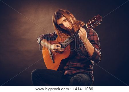 Guitarist Trying Out Chords.