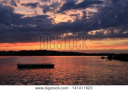 Summer scene in Zurich Canton. Sunset at Lake Pfaeffikersee.