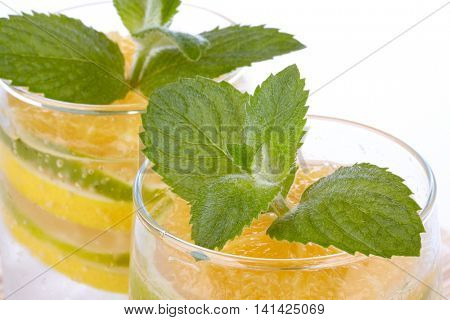 Summer fruity drink with ice on a white background.