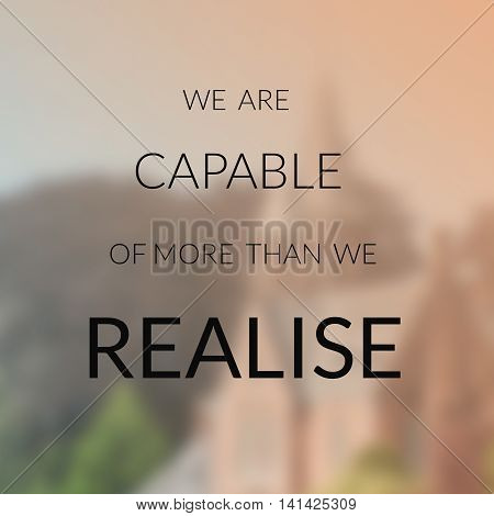 Inspirational quote on blurred background......we are capable of more than we realise