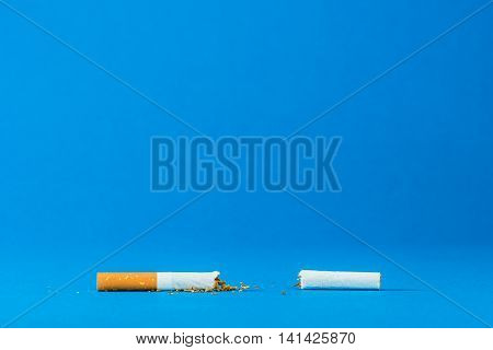 simple paper tobacco on the blue background