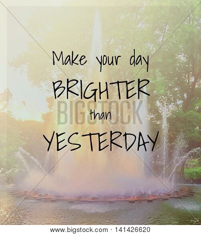 Inspirational quote on blurred background ...make your day brighter than yesterday