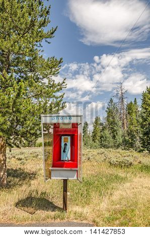 Pay phones are becoming hard to find. This one is easy to see with its bright red paint.