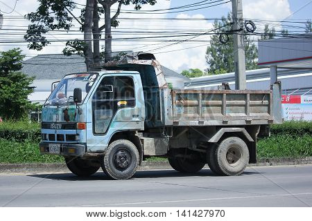CHIANGMAI THAILAND -JULY 27 2016: Private Old Isuzu Dump Truck. On road no.1001 8 km from Chiangmai Business Area.