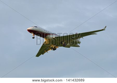 SAINT PETERSBURG, RUSSIA - JULY 03, 2016: The Bombardier BD-700-1A11 Global 5000 M-KBSD) in cloudy sky