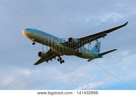 SAINT PETERSBURG, RUSSIA - JULY 03, 2016: Korean Airbus A330-323 (HL7584) Korean Air Lines in a cloudy sky