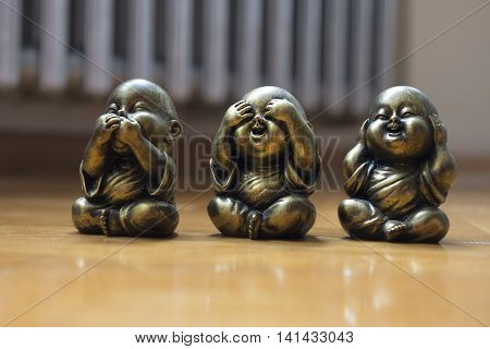 Three Wise Buddha See Hear Speak No Evil Statue on the floor