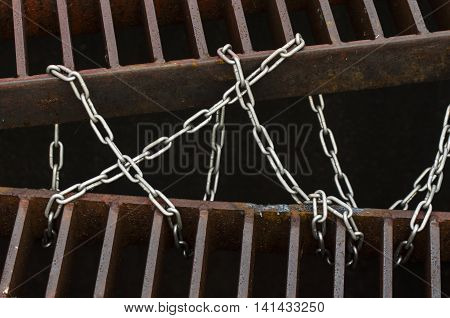 Chain tied drain cap iron and steel background