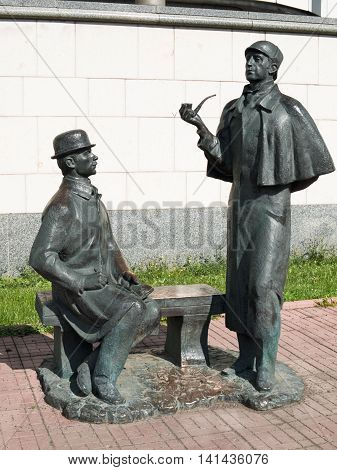 August 2016, Moscow, Russia. Monument to Sherlock Holmes and Dr. Watson near the British Embassy. Heroes of the Soviet TV series performed by Vasily Livanov (Holmes) and Vitaly Solomin (Watson). Sculptor Andrey Orlov