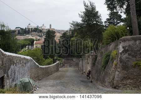 ROME ITALY - JULY 23 2016: tourists climbing the ancient roman street Clivio di Rocca Savella on the Aventine hill
