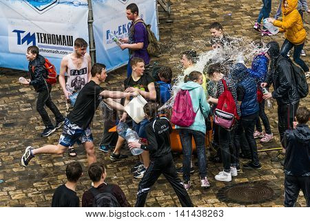 Lviv Ukraine - 2 May 2016: Celebration pouring water on Monday after Easter by the town hall. Townspeople pour water on each other.