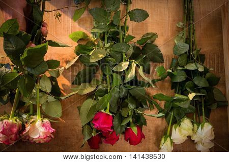 Close-up of flowers on the wooden worktop at flower shop