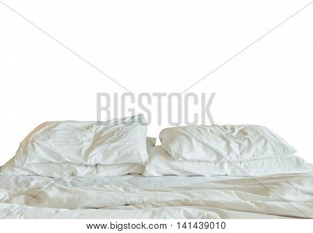 Bedding sheets and pillows up after nights sleep isolate on white blackground. Messy bed concept with clipping path.