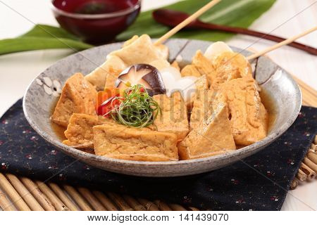 Sue fried fish paste tofu soup with mushroom and onion on chinese plate