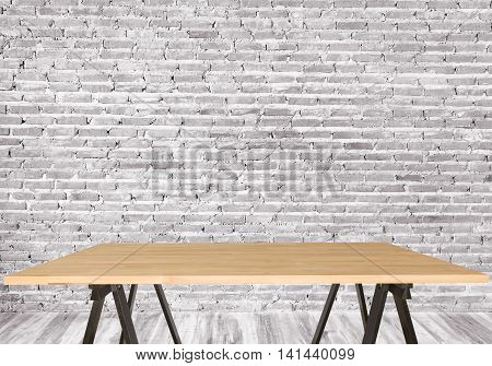 Wooden table in an empty room wall background. - can be used for display your products or promotional and advertising posters