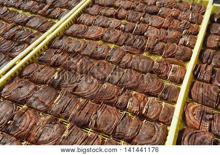 Sliced ganoderma mushroom frying on tray in asia