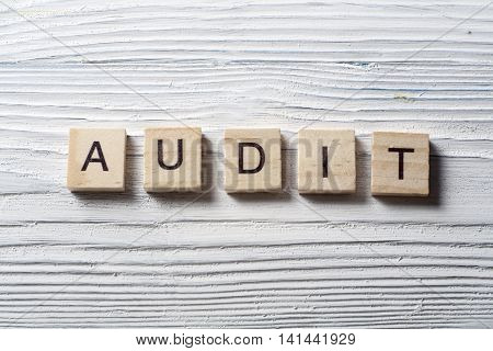 AUDIT word written on wood abc block.
