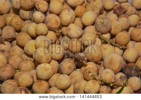 southern langsat, bunch of Southern langsat fruit as background