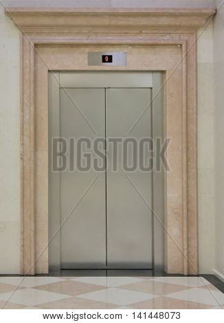 One closed elevator in the shiny building
