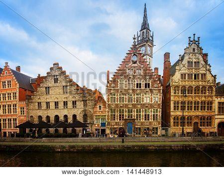 Old buildings embankment of Graslei harbor at day, Ghent, Belgium, retro toned