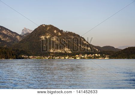 The Fuschlsee during summer season with it's beautiful surrounding landscape and the Schafberg mountain in the background