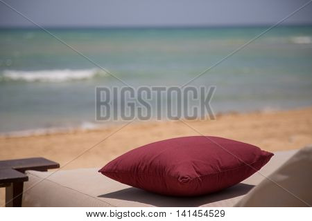 Pillow at the beach with ocean in background