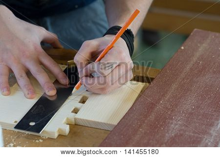 Carpenters marked with the help of a tool piece of wood