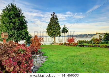 Backyard View Of Water Front Home In  Redondo Washington