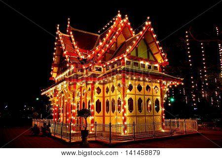 Hua Hin Thailand - December 31 2009: The charming Royal Waiting Room with its decorative night illuminations at the Hua Hin Railway Station *